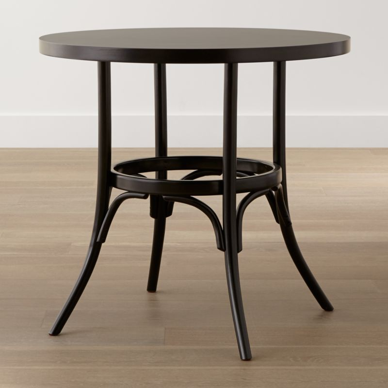 The Vienna bentwood bistro table creates a cozy spot for casual meals or afternoon coffee.  Produced at one of the original Thonet bentwood chair factories, our update on the café classic reappears in beautiful black. <NEWTAG/><ul><li>Beechwood veneer over engineered tabletop</li><li>Hand-bent beech legs</li><li>Black painted finish with three layers of clear protective topcoat</li><li>Seats four</li><li>Made in Poland</li></ul><br />