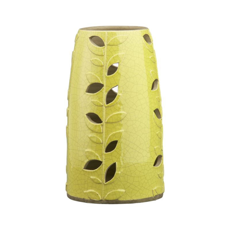 "Day or night, vibrant hurricane shines vivid color and casual charm.  Whimsical earthenware vessel sprouts hand-embossed leafy vines with alternating cut outs for glimpses of flickering candlelight. Hurricane is glazed bright apple green with crackle graze and accommodates a 3""-diameter pillar candle.<br /><br /><NEWTAG/><ul><li>Earthenware</li><li>Wipe clean with damp cloth</li><li>Hurricane accommodates up to 3""-dia. pillar candle, sold separately</li><li>Made in The Philippines</li></ul>"