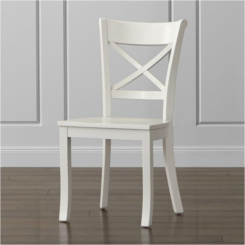 """Painted in classic kitchen white, our Vintner side chair takes inspiration from the substantial styling of classic farmhouse seating. Sustainable solid wood construction is highlighted by the contoured """"X"""" back and comfortable, carved seat to support you in all the right places. The Vintner White Side Chair is a Crate and Barrel exclusive.<br /><br /><NEWTAG/><ul><li>Sustainable solid rubberwood</li><li>White painted finish with clear lacquer topcoat</li><li>Made in Vietnam</li></ul><br /><br />"""