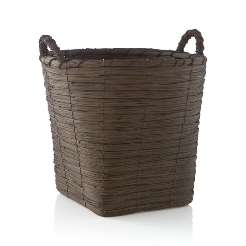 Handwoven basket is stained rich brown to bring out the organic texture of natural fiber. Tall round basket tapers to a sturdy square base, ready to receive towels, toys and household clutter.<br /><br /><NEWTAG/><ul><li>Handcrafted</li><li>Wood chip, fiber rope and wire with plastic tube</li><li>Made in China</li></ul>