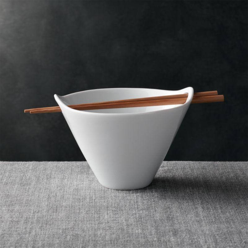 Modern Asian serving shape in white porcelain rests bamboo chopsticks in the cutout handles.<br /><br /><NEWTAG/><ul><li>Porcelain and bamboo</li><li>Hand wash bamboo chopsticks</li><li>Porcelain is dishwasher-, microwave- and oven-safe</li><li>Made in China</li></ul>