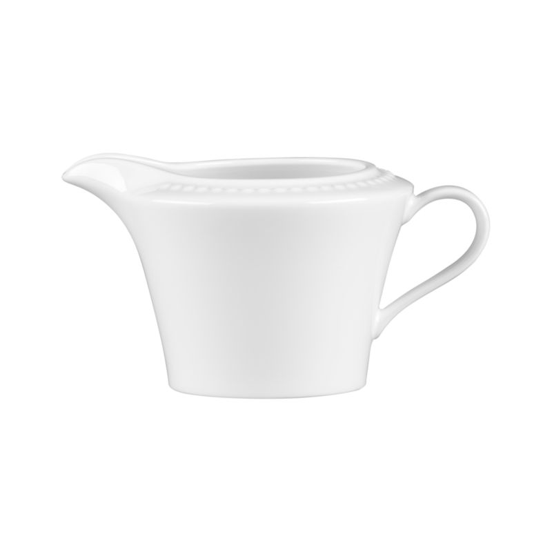 Inspired by the simple elegance of a pearl. Beautiful embossed dots on white bone china create a durable creamer with timeless appeal. White Pearl dinnerware also available.<br /><br /><NEWTAG/><ul><li>Superior quality and design</li><li>Dishwasher- and microwave-safe</li><li>By Nikko Ceramics</li><li>Made in Japan</li></ul>