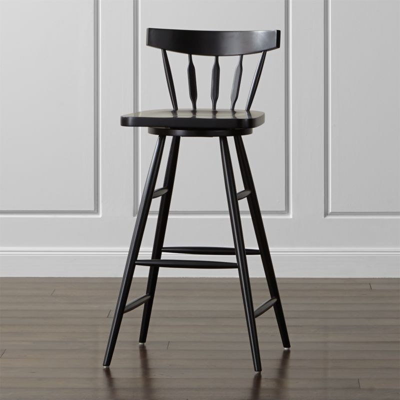 Take a spin at the bar on our Windsor-inspired stool, scaled tall and designed with a 360-degree swivel and comfortable footrest. An iconic symbol of America's independent spirit, the Windsor chair has been a fixture in parlors and pubs, living rooms and kitchens for almost three centuries.  <NEWTAG/><ul><li>Designed by Mark Daniel of Slate</li><li>Beechwood frame with black finish and clear lacquer topcoat</li><li>Mortise and tenon joinery</li><li>360-degree swivel mechanism</li><li>Feet with plastic glides</li><li>Made in China</li></ul><br />