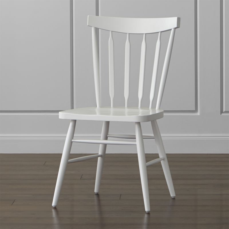 Our Willa side chair brings the classic Windsor chair up to date with its elegant beechwood frame, slender spindle back, angled legs and subtle saddle seat. An icon of America's independent spirit, the Windsor chair has been at home in parlors and pubs, living rooms and kitchens for almost three centuries. <NEWTAG/><ul><li>Designed by Mark Daniel of Slate</li><li>Beechwood frame with white finish and clear lacquer topcoat</li><li>Mortise and tenon joinery</li><li>Made in China</li></ul><br />