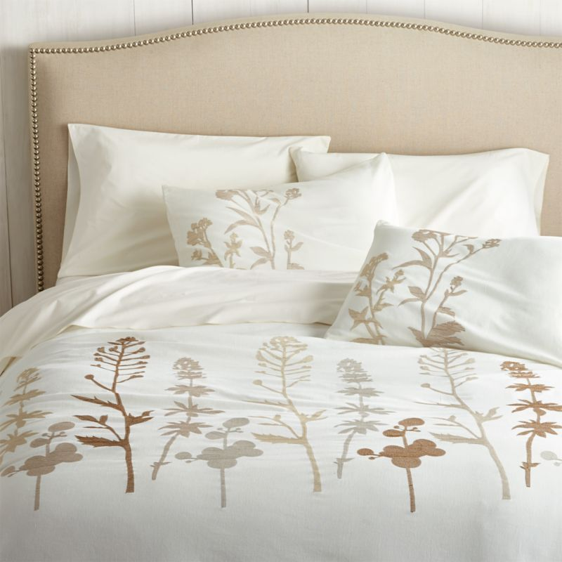 Woodland plants blanket cotton-linen fabric in a forest of embroidered silhouettes, taking shape in a range of soft neutrals on ivory. Duvet has a hidden button closure and interior fabric ties to hold the insert in place. Reverses to solid ivory. Duvet inserts also available.<br /><br /><NEWTAG/><ul><li>88% cotton and 12% linen</li><li>100% rayon embroidery</li><li>Machine wash cold, tumble dry low</li><li>Made in India</li></ul>