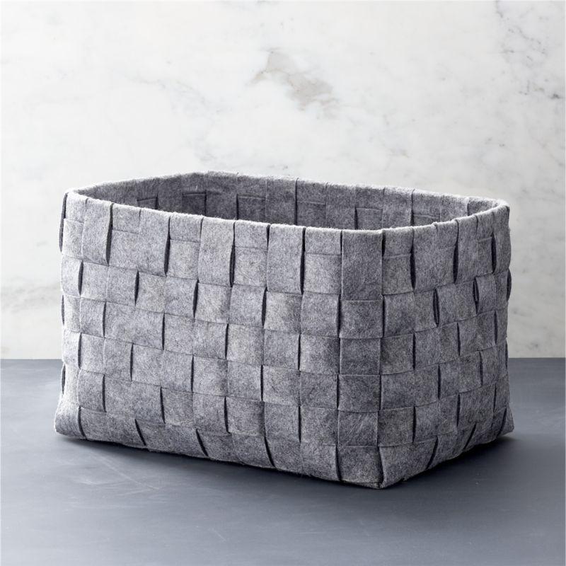 A classic basketweave design is reimagined in heathered grey felt, creating a soft, neutral statement in open storage. A natural in any room.<br /><br /><NEWTAG/><ul><li>100% polyester</li><li>22-lb. capacity</li><li>Dry clean</li><li>Made in China</li></ul>