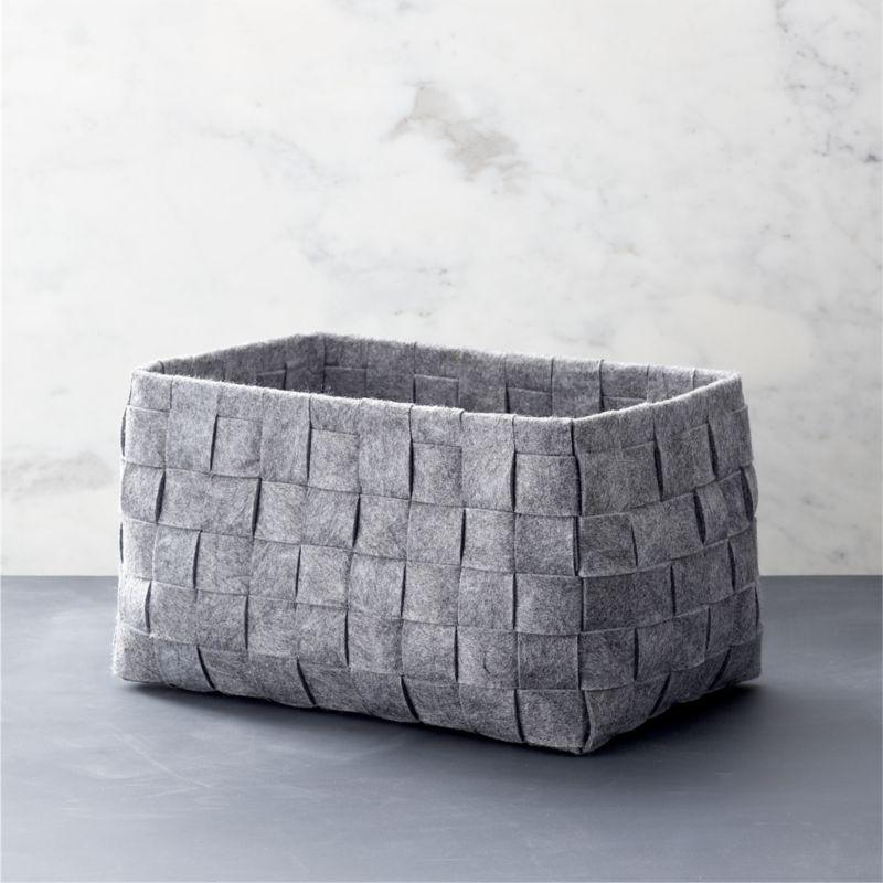 A classic basketweave design is reimagined in heathered grey felt, creating a soft, neutral statement in open storage. A natural in any room.<br /><br /><NEWTAG/><ul><li>100% polyester</li><li>17.5-lb. capacity</li><li>Dry clean</li><li>Made in China</li></ul>