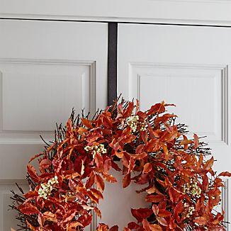 This simply styled over-the-door wreath hook adds an artisanal look to holiday décor. Each hook, finished in bronze, is handcrafted with all-over hammered texture.