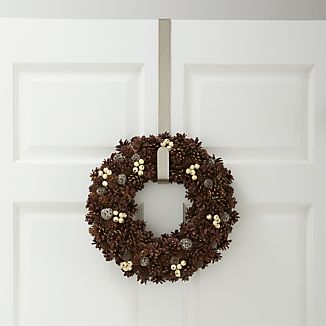 This simply styled over-the-door wreath hook adds an artisanal look to holiday décor. Each hook, finished in brushed silver, is handcrafted with all-over hammered texture.