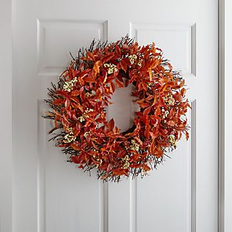 Realistic twigs of deep rust-hued leaves and white berries fashion a gorgeous autumn wreath. Displayed on a covered front door or above the mantle, the wreath extends a warm fall welcome.