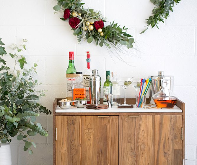 A table with various cocktail prepping tools on it