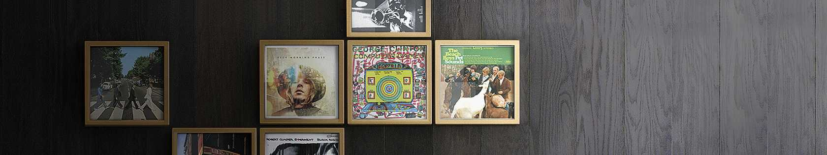Framed albums on a wall