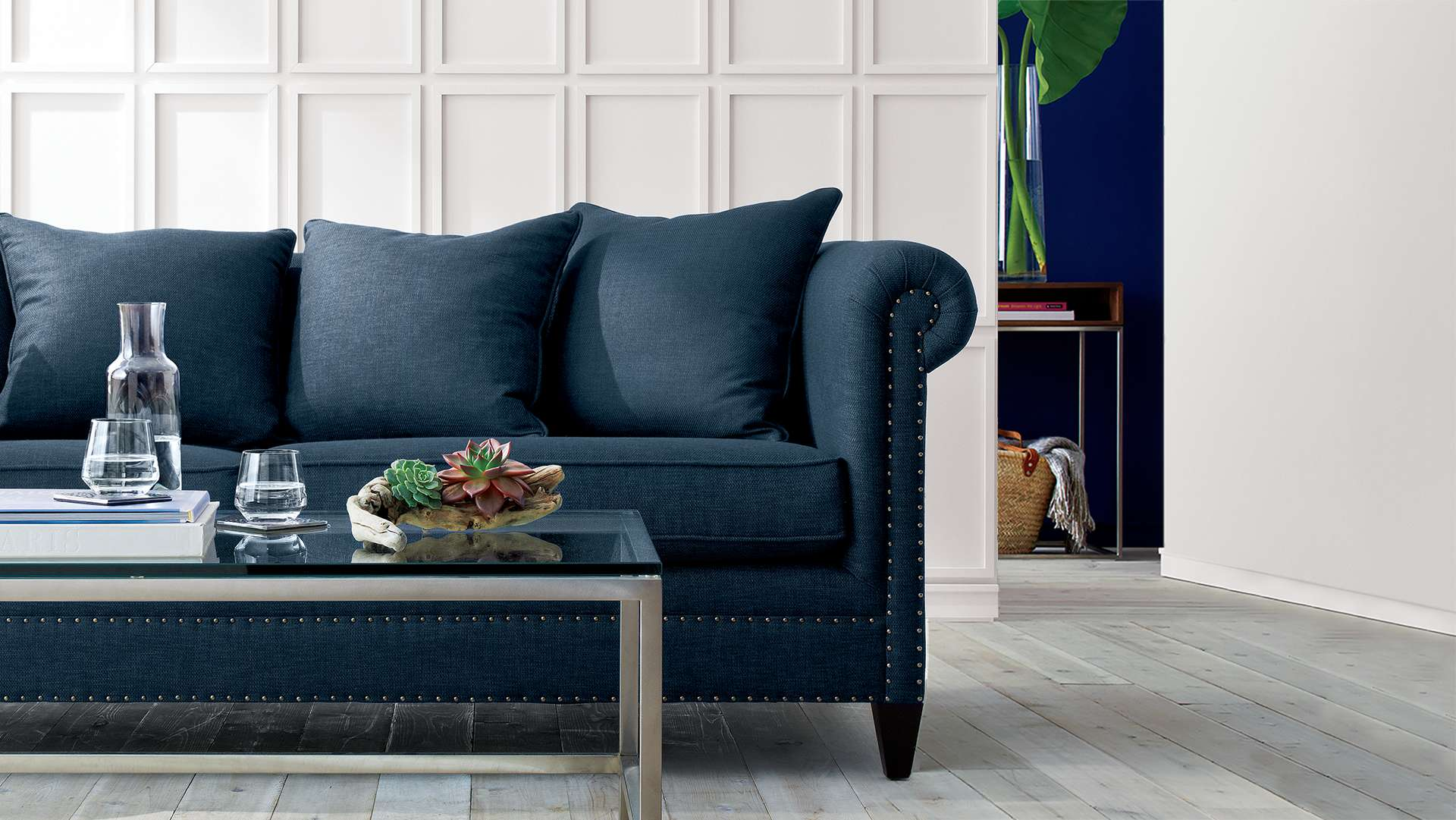 Blue Durham sofa in white room