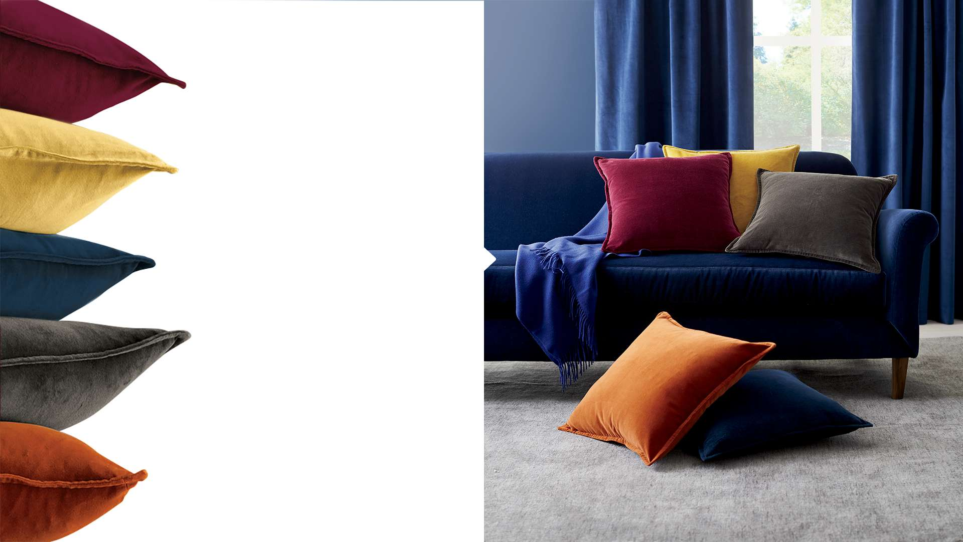 Velvet pillows stacked and in a pile on a velvet sofa