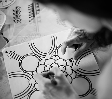 Genevieve drawing a pattern by hand