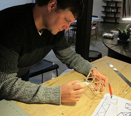Mark Daniel building a model design of a piece of furniture