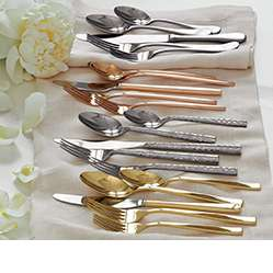 Different flatware patterns laid out on a table