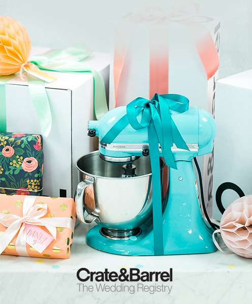Wrapped gift boxes on a table with an Aqua KitchenAid Stand Mixer with a box on it