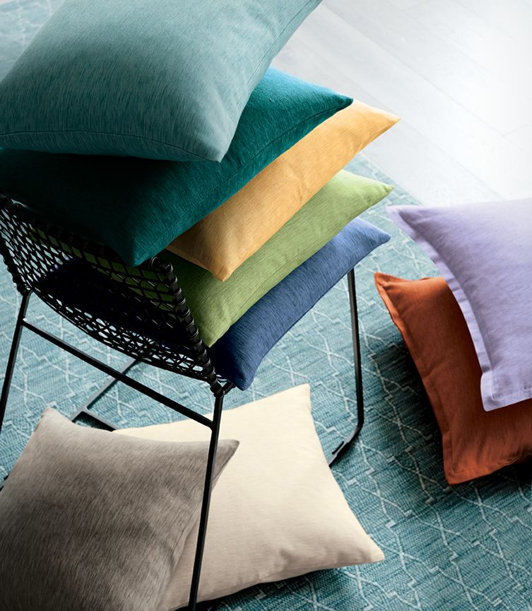 Colorful Michaela, Trevino and Brenner decorative pillows in blue, yellow, green, orange, purple and brown shades.