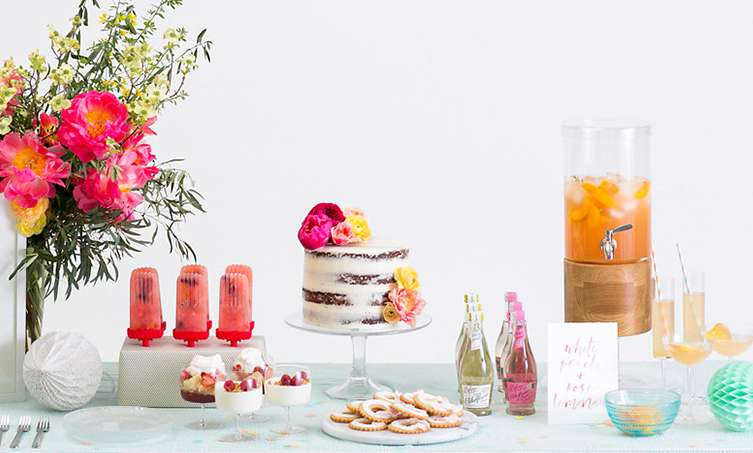 Drinks, parfaits, cake and popsicles displayed for a party