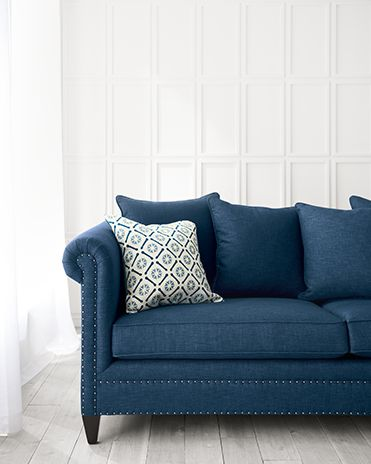 Durham Blue Sofa on a whitewashed hardwood floor