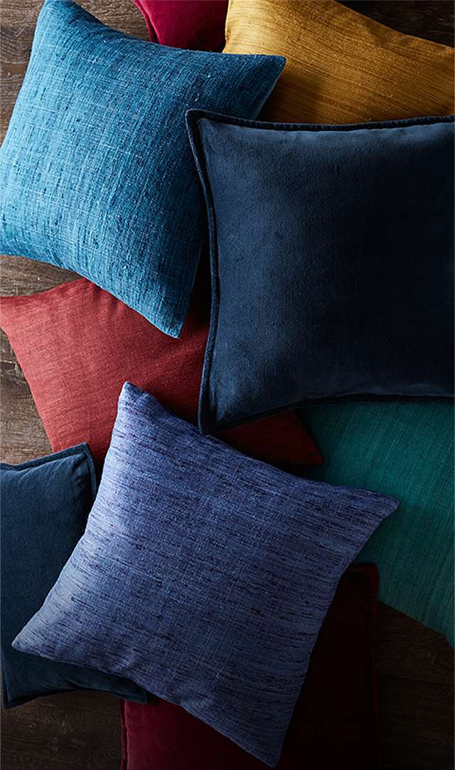 pile of jewel toned pillows