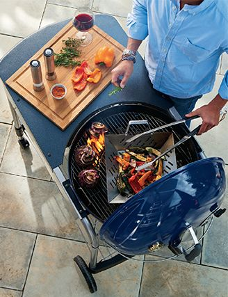 Grilling on a blue Weber Grill