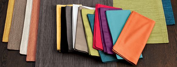 placemats and napkins in multiple colors laid out on a table