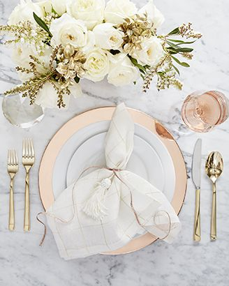 Glam table setting featuring Aspen Dinnerware with Copper Plated Charger and Emory Gold Flatware