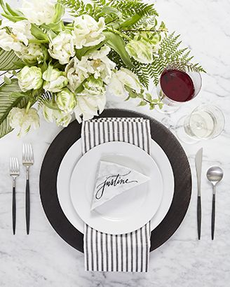 Modern table setting featuring Aspen Dinnerware with Evans Wood Charger Plate, Aero Flatware and Liam Grey Stripe Napkin