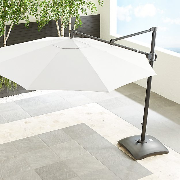 10' Sunbrella ® White Sand Round Cantilever Umbrella with Base - Image 1 of 8