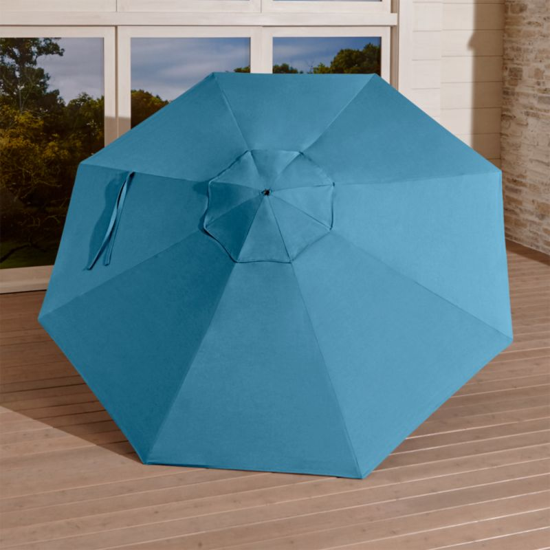 This generous canopy in deep blue Sunbrella solution-dyed acrylic resists fading and mildew while blocking out 98% of the sun's rays. Fits our 9' round frames. The 9' Round Sunbrella Turkish Tile Outdoor Umbrella Canopy is a Crate and Barrel exclusive.<br /><br /><NEWTAG/><ul><li>Fade- and mildew-resistant Sunbrella acrylic (fits all 9' round frames)</li><li>Frames (sold separately): adjustable FSC-certified eucalyptus with solid brass pulley; or aluminum tilt with silver or black finish</li><li>Stands (sold separately): rustproof resin and stone-polyester mixture, in charcoal finish.</li><li>Made in USA or China of domestic and imported materials</li></ul>