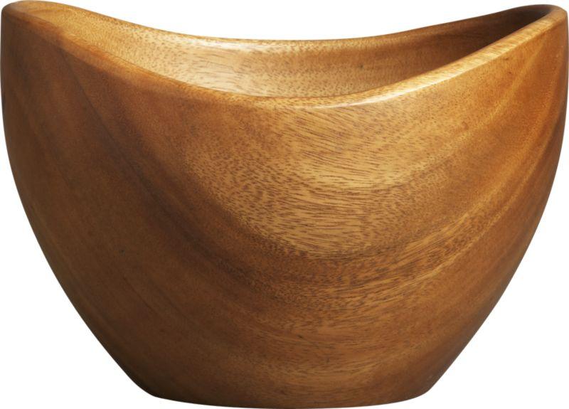 The organic shape and rich sweeping grain of solid acacia wood make this salad bowl a natural for entertaining.<br /><br /><NEWTAG/><ul><li>Plantation-grown acacia wood</li><li>Foodsafe finish</li><li>Hand wash</li><li>Made in The Philippines</li></ul>
