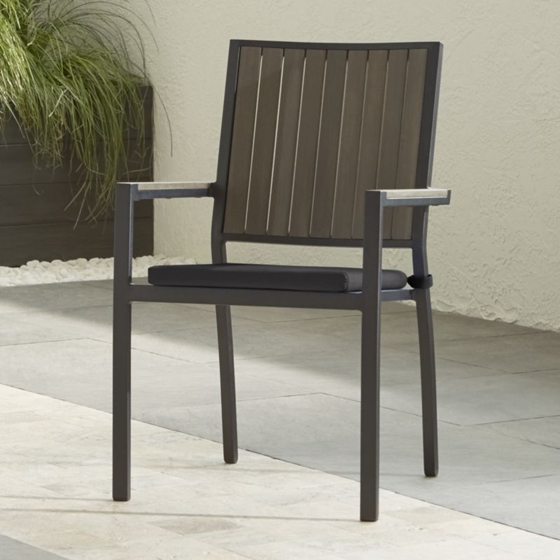 Casual and stylish, our stackable Alfresco outdoor dining chair fools the eye with the look of real wood and fools the elements with UV- and fade-resistant qualities for outdoor living. Slats of innovative warm grey polystyrene faux wood are treated with UV and anti-oxidant protection. <NEWTAG/><ul><li>Extruded polystyrene with UV and anti-oxidant protection</li><li>Aluminum frame with powdercoat finish</li><li>Fade- and mildew-resistant Sunbrella acrylic cushion</li><li>Foam cushion fill</li><li>Fabric tab fasteners</li><li>Stacks up to 4 high for easy storage</li><li>Made in USA and China of domestic and imported materials</li></ul><br /><br />