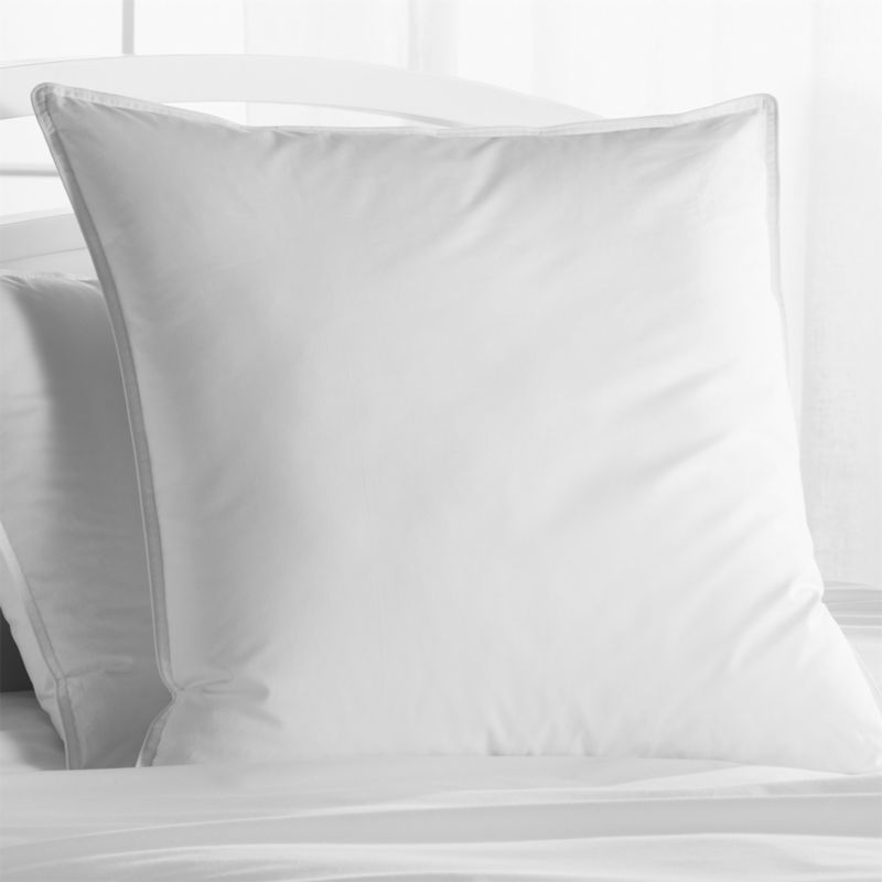 Down-like yet down-free, our plump, hypoallergenic down alternative pillows are encased in 230-thread-count cambric cotton and filled with Italian-crafted synthetic microfiber clusters, developed to closely resemble the feel of the real thing. <a href=/feather-down-bed-pillows/f11504>Feather-Down Bed Pillows</a> and <a href=/premium-down-bed-pillows/f58248>Premium Down Bed Pillows</a> also available.<br /><br /><NEWTAG/><ul><li>100% cambric cotton cover</li><li>Microfiber cluster fill, 29 oz.</li><li>Sized to fit our pillowcases</li><li>Machine wash in warm water, like colors, no bleach</li><li>Tumble dry, medium heat until thoroughly dry</li><li>For best results, professional laundering is recommended</li><li>Do not dry clean</li><li>Made in multiple countries of domestic and imported materials</li></ul>