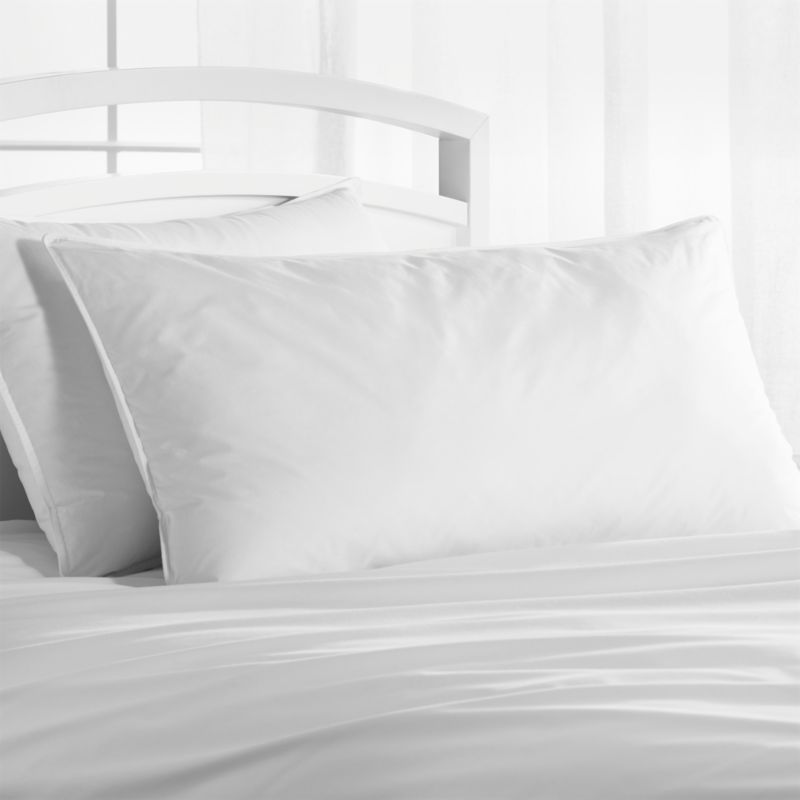 Down-like yet down-free, our plump, hypoallergenic down alternative pillows are encased in 230-thread-count cambric cotton and filled with Italian-crafted synthetic microfiber clusters, developed to closely resemble the feel of the real thing. <a href=/feather-down-bed-pillows/f11504>Feather-Down Bed Pillows</a> and <a href=/premium-down-bed-pillows/f58248>Premium Down Bed Pillows</a> also available.<br /><br /><NEWTAG/><ul><li>100% cambric cotton cover</li><li>Microfiber cluster fill, 28 oz.</li><li>Sized to fit our pillowcases</li><li>Machine wash in warm water, like colors, no bleach</li><li>Tumble dry, medium heat until thoroughly dry</li><li>For best results, professional laundering is recommended</li><li>Do not dry clean</li><li>Made in multiple countries of domestic and imported materials</li></ul>
