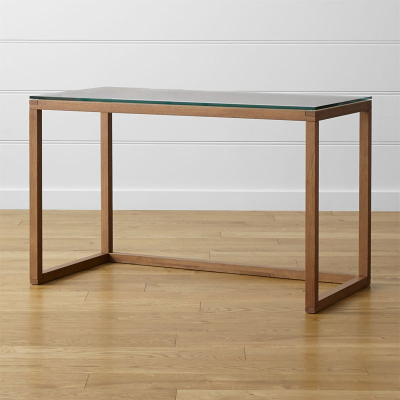 Anderson distills the workspace down to a geometric essence in an open frame of solid oak infused with a warm brown hue that floats a desktop of cool, clear tempered glass. <NEWTAG/><ul><li>Designed by Mark Daniel of Slate</li><li>Solid oak frame with acorn brown lacquer finish</li><li>As with all solid woods, expansion and contraction may occur with seasonal changes in humidity</li><li>Tempered clear glass top</li><li>Levelers</li><li>Made in Vietnam</li></ul>