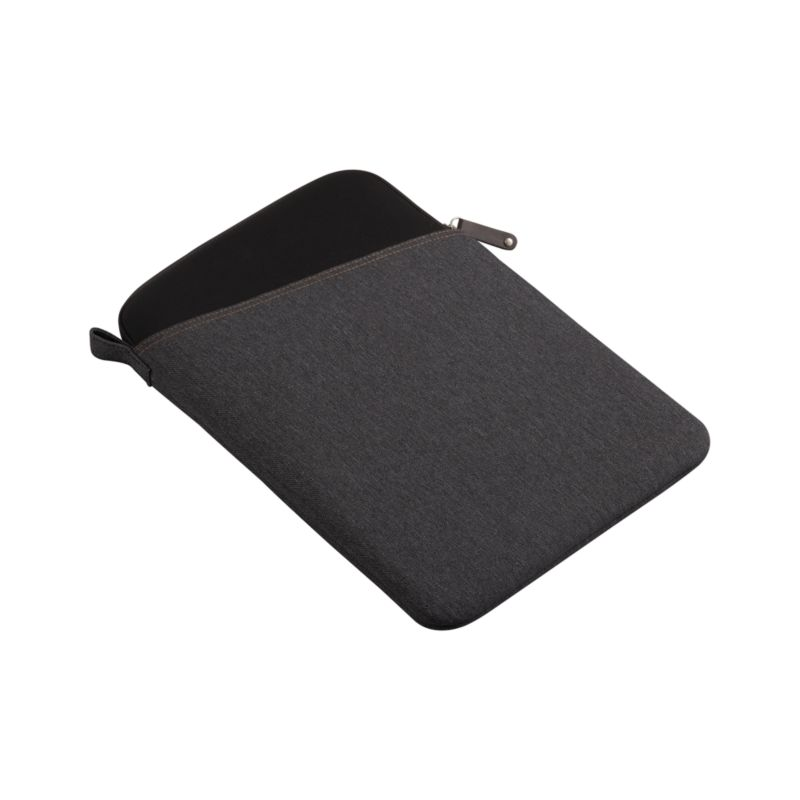"""Casual denim sleeve protects and cushions computers with a durable, water-resistant polyester casing and neoprene interior. Angled exterior pocket stores papers, chargers and more with easy access.<br /><br /><NEWTAG/><ul><li>100% polyester exterior</li><li>100% neoprene interior</li><li>Accommodates a 13"""" laptop</li><li>Zipper closure</li><li>Water-resistant</li><li>Clean with a damp cloth</li></ul><br />"""