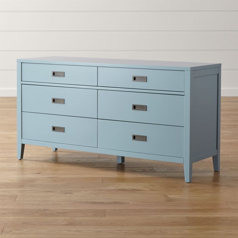 In a fresh take on classic cottage bedroom furniture, designer Blake Tovin frames 6 drawers with a lean, solid poplar frame, all lacquered a refreshing blue. Grace notes of a trim divider between the upper and lower two drawers, inset antique brass pulls and smartly tapered legs update the dresser's classic aesthetic without sacrificing an ounce of charm. The Arch Blue 6-Drawer Dresser is a Crate and Barrel exclusive.<br /><br /><NEWTAG/><ul><li>Designed by Blake Tovin of Tovin Design</li><li>Solid poplar, engineered wood and plywood with blue lacquer finish over white sealer</li><li>Naturally expands and contracts with changes in humidity</li><li>6 drawers with metal side-mounted glides</li><li>Antique brass pulls</li><li>Levelers</li><li>Made in Vietnam</li></ul>