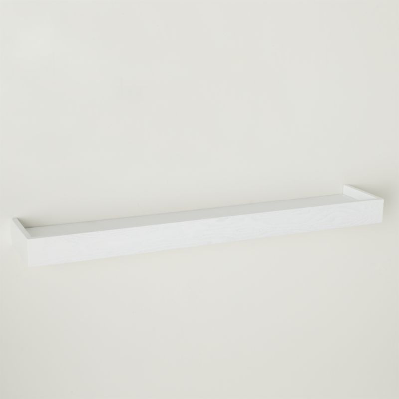 Light, white ledge makes it easy to display photos or artwork. Lightweight and sturdy shelf gets its hidden strength from a hollow-core construction, supporting up to 100 pounds. Combine with Archetype's other sizes for a functional, dimensional wall display.<br /><br /><NEWTAG/><ul><li>Engineered wood with ash veneer</li><li>White lacquer finish</li><li>Supports up to 100 lbs.</li><li>Hardware included</li><li>Dust with soft cloth</li><li>Made in China</li></ul>