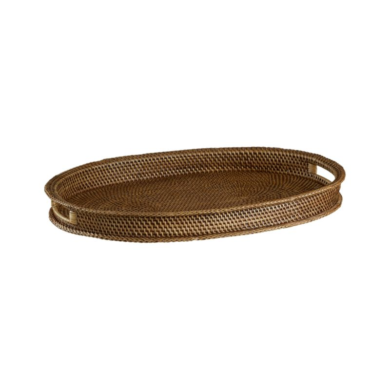A honey brown finish warms this handcrafted rattan tray. Each is made with a fine, tight weave and comfortable, sturdy cutout handles.<br /><br /><NEWTAG/><ul><li>Handwoven rattan</li><li>Honey brown finish</li><li>Foodsafe lacquer finish</li><li>Liner recommended to extend wear</li><li>Clean with a dry cloth</li><li>Made in The Philippines</li></ul>