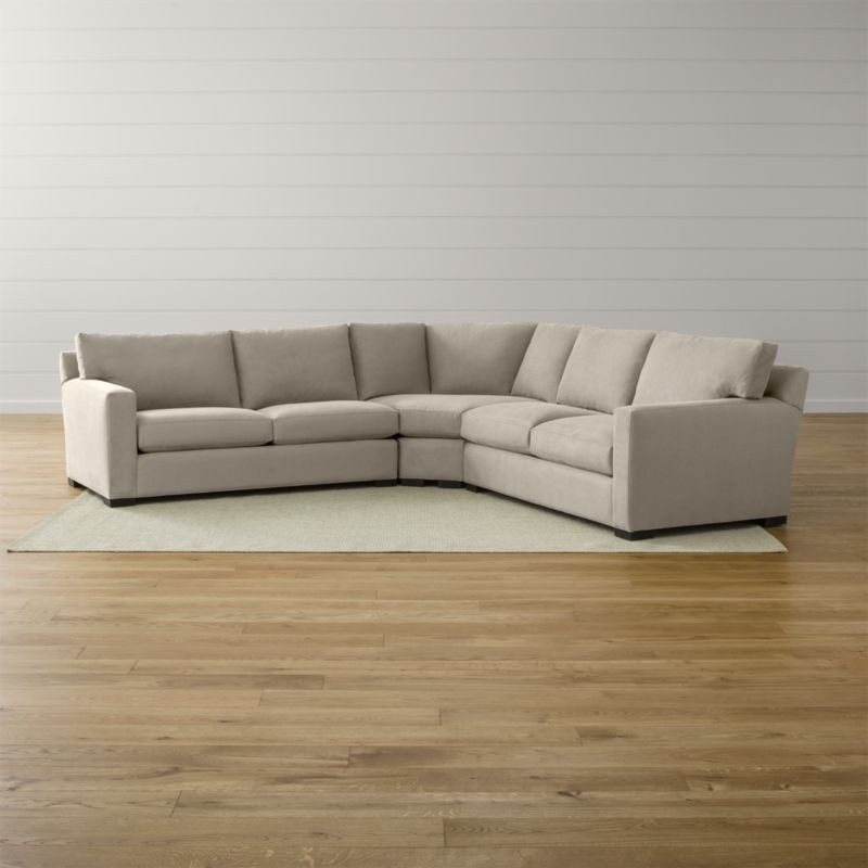 Bring Axis home and watch life revolve around it. Upholstered in a high-performance fabric that's pet, kid, and family friendly, this collection offers exceptional durability for family rooms and casual living rooms—and the versatility to customize your ideal sectional. This 3-piece sectional is comprised of the left arm apartment sofa, right arm apartment sofa and wedge.  <NEWTAG/><ul><li>Frames are benchmade with certified sustainable hardwood that's kiln-dried to prevent warping</li><li>Flexolator spring suspension systems</li><li>Soy-based polyfoam seat cushions wrapped in fiber-down blend and encased in downproof ticking</li><li>Fiber-down back cushions encased in downproof ticking</li><li>Hardwood legs stained with a rich brown finish</li><li>Made in North Carolina, USA</li></ul><br />