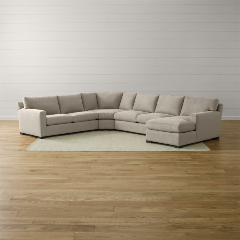 Bring Axis home and watch life revolve around it. Upholstered in a high-performance fabric that's pet, kid, and family friendly, this collection offers exceptional durability for family rooms and casual living rooms—and the versatility to customize your ideal sectional. This 4-piece sectional is comprised of the left arm apartment sofa, armless loveseat, right arm chaise and wedge. <NEWTAG/><ul><li>Frames are benchmade with certified sustainable hardwood that's kiln-dried to prevent warping</li><li>Flexolator spring suspension systems</li><li>Soy-based polyfoam seat cushions wrapped in fiber-down blend and encased in downproof ticking</li><li>Fiber-down back cushions encased in downproof ticking</li><li>Hardwood legs stained with a rich brown finish</li><li>Made in North Carolina, USA</li></ul><br />