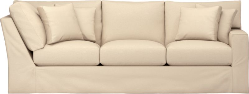 "Snug-fitting slipcovers hug Axis's deep and roomy contours, tailor-made with sleek floor-length skirt and crisp topstitching.<br /><br />Additional <a href=""http://crateandbarrel.custhelp.com/cgi-bin/crateandbarrel.cfg/php/enduser/crate_answer.php?popup=-1&p_faqid=125&p_sid=DMUxFvPi"">slipcovers</a> available through stores featuring our Furniture Collection.<br /><br />After you place your order, we will send a fabric swatch via next day air for your final approval. We will contact you to verify both your receipt and approval of the fabric swatch before finalizing your order.<br /><br /><NEWTAG/><ul><li>Machine washable</li><li>Topstitching detail</li><li>See additional frame options below</li><li>Made in North Carolina, USA</li></ul>"
