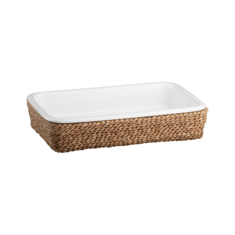 A beautiful serving solution nests an oven-to-table white porcelain rectangle in a rustic handwoven fiber basket. Decorative and functional, the basket serves as a trivet to protect tables and countertops, or can be used separately for breads and rolls. Perfect for passing hot dishes at the table.<br /><br /><NEWTAG/><ul><li>High fired porcelain baker</li><li>All natural bankuang fiber basket</li><li>Basket is food safe</li><li>Dishwasher-, freezer-, microwave- and oven-safe</li><li>Clean basket with a dry cloth only</li></ul>