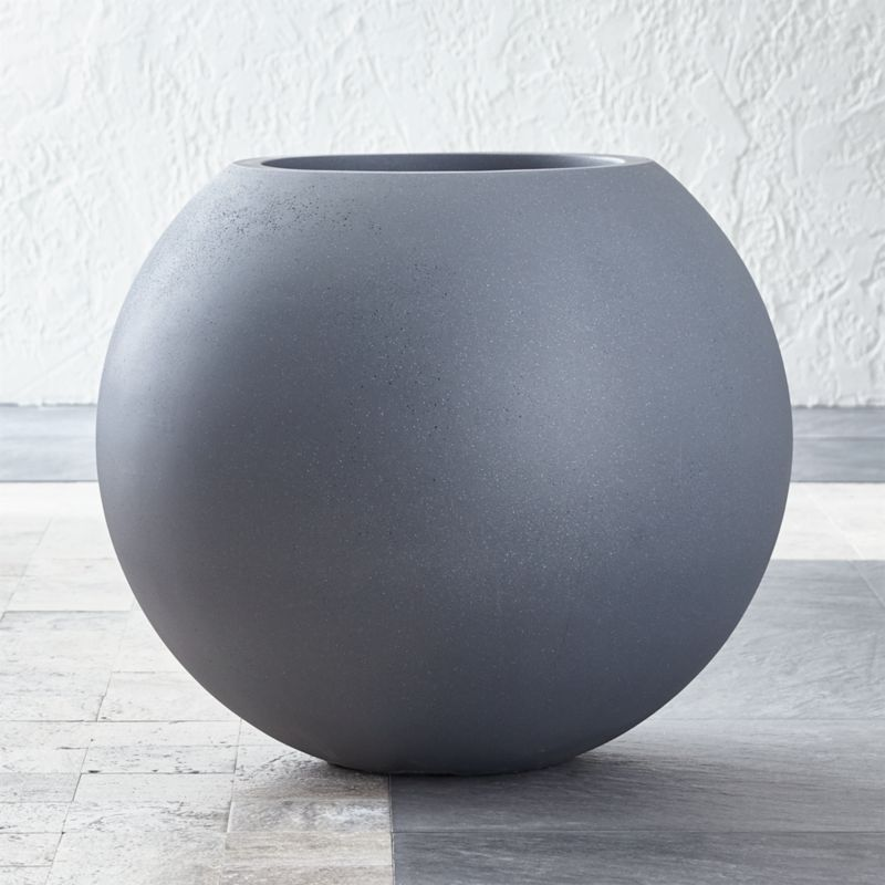 Earth-friendly globe planter does a world of good, cast of naturally derived mineral compounds, sea salt, sand and fiber and manufactured with low emissions and minimal energy use. Grey-toned planter makes the rounds in a textured organic finish and can withstand all kinds of weather.<br /><br /><NEWTAG/><ul><li>Mineral compounds, sea salt, sand and fiber</li><li>Zero VOC emissions</li><li>Drainage hole</li><li>Weighs 61 pounds</li><li>Frost-, heat-, mold-, mildew- and termite-resistant</li><li>Made in China</li></ul>