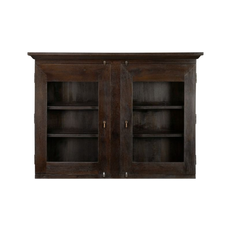 Handcrafted entirely of sustainable solid mango wood with glass doors to display favorite objects, the boldly proportioned Basque hutch provides 4 fixed shelves of convenient storage atop the Basque buffet. With a simple, rustic presence and the heft and character of a European farmhouse antique, this hutch is finished with authentic peg joinery, dangling cast brass pulls and traditional hasp closures. <NEWTAG/><ul><li>Sustainable solid mango wood</li><li>Java brown stain with lacquer and wax finish</li><li>Hand-planed wooden planks</li><li>Peg detailing</li><li>Naturally occurring grain and knots</li><li>4 fixed shelves: 2 per side behind 2 glass door fronts</li><li>Cast brass pulls and hasp closures</li><li>Made in India</li></ul>