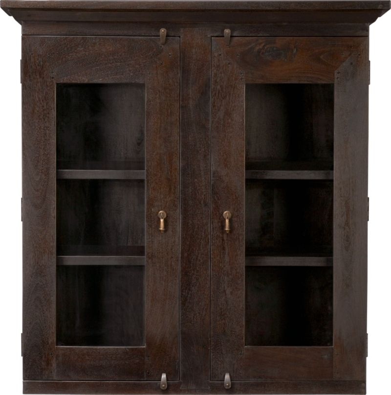 Hutch top with glass doors features rustic, handcrafted detailing and antique appeal scaled for smaller spaces. The deep java finish is waxed to a soft sheen. The java finish is waxed to a soft sheen. Basque java accent tables also available.<br /><br /><NEWTAG/><ul><li>Handcrafted</li><li>Sustainable, kiln-dried solid mango wood</li><li>Peg detailing</li><li>Naturally occurring grain and knots</li><li>Deep java finish</li><li>Four fixed shelves: two per side</li><li>Dangling, cast brass pulls and rustic hasp closures</li></ul>