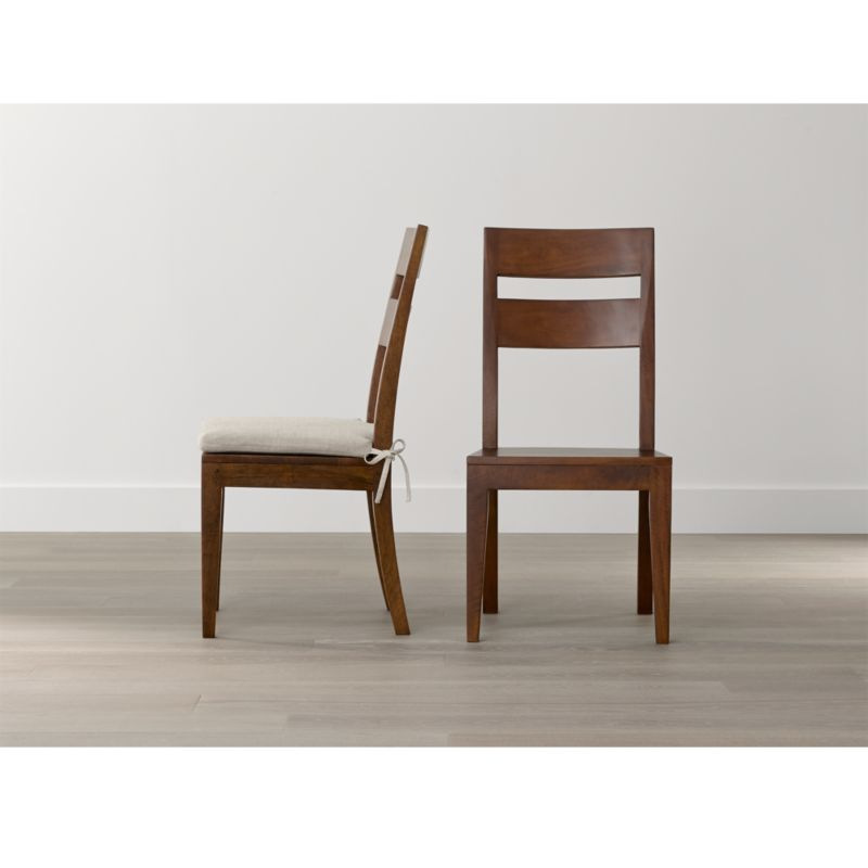 Basque honey wood dining chair and cushion crate and barrel for Wooden dining room chairs