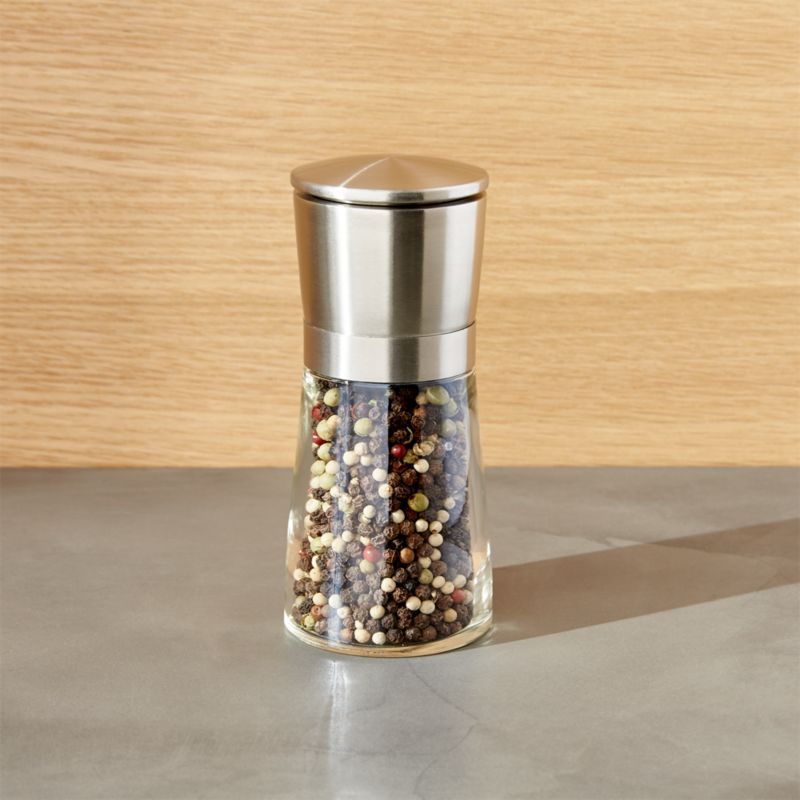 Sleek stainless mill offers unique modern styling and seasoning. Remove stainless cap to reveal adjustable grinding mechanism and dispense pepper. Smart design prevents residual spill.<br /><br /><NEWTAG/><ul><li>Comes filled with peppercorns</li><li>Carbon steel grinder (not for use with salt)</li><li>Made in China</li></ul>